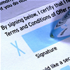 Terms of use image depicting someone signing a terms and conditions agreement